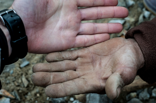 Hands: the worn hands of a professional stonebreaker juxtaposed with the pale, cold, bloodless hand of yours truly