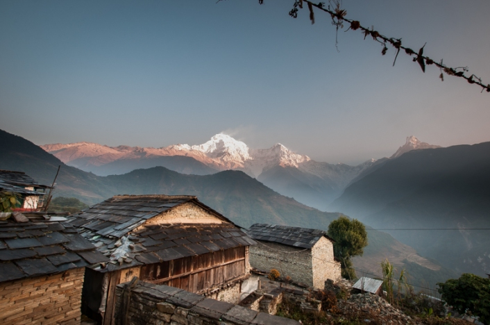Morning sunshine lights up fresh snow on Annapurna South and approaching ridgelines