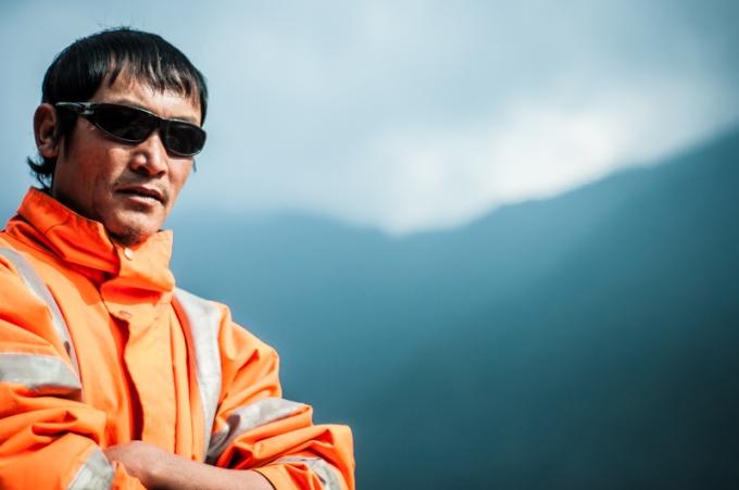 Pratap Rana - his high viz jacket in interesting juxtaposition with his mother's traditional hillside garb